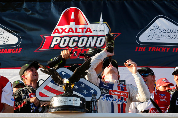 Monster Energy NASCAR Cup Series AXALTA presents the Pocono 400 Pocono Raceway, Long Pond, PA USA Sunday 11 June 2017 Ryan Blaney, Wood Brothers Racing, Motorcraft/Quick Lane Tire & Auto Center Ford Fusion celebrates in victory lane  World Copyright: Russell LaBounty LAT Images ref: Digital Image 17POC1rl_05397