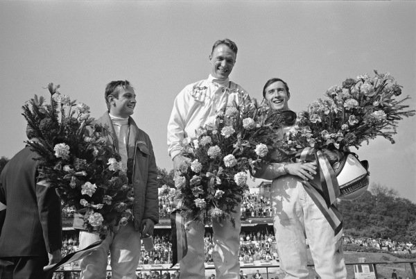 Dan Gurney, Chris Amon and Jackie Stewart on the podium.