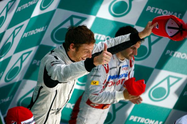 Sepang, Kuala Lumpur, Malaysia5th April 2009Jenson Button, Brawn GP BGP001 Mercedes, 1st position, celebrates on the podium. Portrait. Podium. World Copyright: Steven Tee/LAT Photographicref: Digital Image _95U0142
