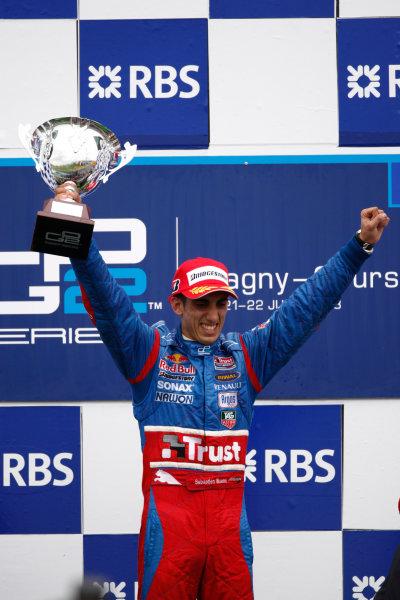 Magny-Cours, France. 22nd June.Sunday Race. Sebastien Buemi (SUI, Trust Team Arden) celebrates his victory on the podium.World Copyright: Andrew Ferraro/GP2 Series Media Service.ref: Digital Image _H0Y8063