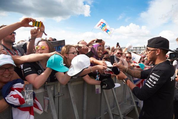 Silverstone Circuit, Northamptonshire, England. Saturday 4 July 2015. Lewis Hamilton, Mercedes AMG, signs autographs for fans. World Copyright: Steve Etherington/LAT Photographic ref: Digital Image SNE18838