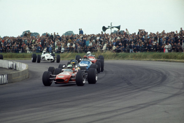 Silverstone, Great Britain. 19 July 1969.Reine Wisell (Chevron B15 - Ford), 4th position, leads Ronnie Peterson (Tecno 69-Novamotor), 3rd position, at the start, action.World Copyright: LAT PhotographicRef: 69BF3 02