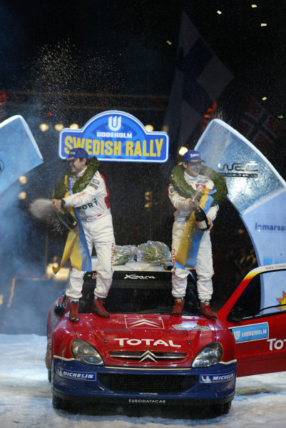 2004 FIA World Rally Champs. Round two, Swedish Rally.5th-8th February 2004.Sebastien Loeb, Citroen, podium.World Copyright: McKlein/LAT