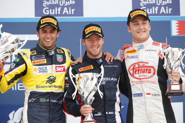 2013 GP2 Series. Round 2.  Bahrain International Circuit, Sakhir, Bahrain. 21st April.  Sunday Race.  Sam Bird (GBR, RUSSIAN TIME) celebrates his victory on the podium with Felipe Nasr (BRA, Carlin) and Stefano Coletti (MON, Rapax).  World Copyright: Glenn Dunbar/GP2 Series Media Service. Ref: _89P4382