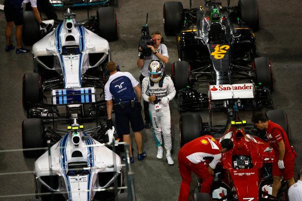 Yas Marina Circuit, Abu Dhabi, United Arab Emirates. Saturday 22 November 2014. Lewis Hamilton, Mercedes AMG, arrives in Parc Ferme after Qualifying. World Copyright: Charles Coates/LAT Photographic. ref: Digital Image _J5R5298