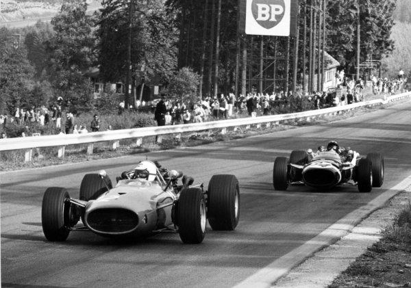 1967 Belgian Grand Prix.Spa-Francorchamps, Belgium. 18 June 1967.Ludovico Scarfiotti, Ferrari 312, not classified, leads Jo Siffert, Cooper T81-Maserati, 7th position, action.World Copyright: LAT PhotographicRef: Motor b&w print