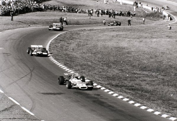 1969 United States Grand Prix Watkins Glen, United States. 5 October 1969 Jean-Pierre Beltoise, Matra MS80-Ford, retired, leads Piers Courage, Brabham BT26-Ford, 2nd position, Jacky Ickx, Brabham BT26-Ford, retired, and John Surtees, BRM P139, 3rd position, action World Copyright: LAT PhotographicRef: b&w print