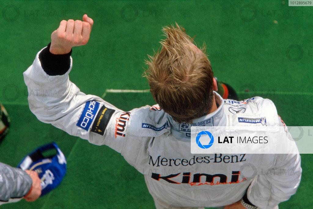 2005 Hungarian Grand Prix. Hungaroring, Hungary. 29th - 31st July 2005 Kimi Raikkonen, McLaren Mercedes MP4-20 celebrates victory on the podium. World Copyright: Steven Tee/LAT Photographi--c Ref: 35mm Image A02