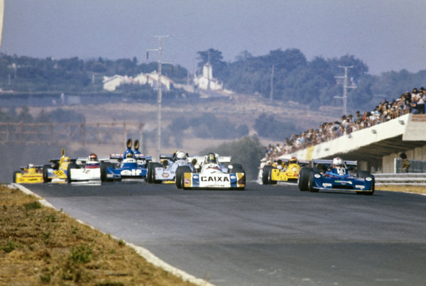 Alex Ribeiro, March 762 BMW/Rosche, battles with Hans Binder, Chevron B35 BMW, as they lead the field at the start.