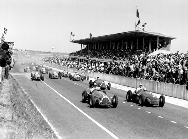 1950 French Grand Prix.Reims-Gueux, France. 2 July 1950.Race winner Juan Manuel Fangio (Alfa Romeo 158, number 6) and Giuseppe Farina (Alfa Romeo 158, number 2) lead Luigi Fagioli (Alfa Romeo 158, number 4), Luigi Rosier (Lago-Talbot T26C-DA, number 20), Philippe Etancelin (Lago-Talbot T26C-DA, number 16), Jose Froilan Gonzalez (Maserati 4CLT/48, number 36) Robert Manzon (Gordini 15, number 44) and Yves Giraud-Canantous (Lago-Talbot T26C-DA, number 18) at the start of the race. Ref: C27335.World Copyright: LAT Photographic