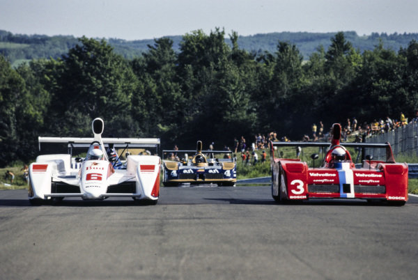 Teo Fabi, Newman Racing, March 817 Chevrolet, and Geoff Brabham, Racing Team V.D.S., Lola T530 Chevrolet, form the field up on the formation lap ahead of the start.