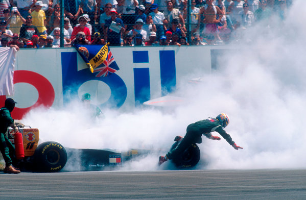 1994 French Grand Prix.Magny-Cours, France.30/6-2/7 1994.Alessandro Zanardi (Lotus 109 Mugen-Honda) retires after his engine caught fire. He made a hasty exit, but only after David Brabham pulled alongside and pointed it out.Ref-94 FRA 01.World Copyright - LAT Photographic