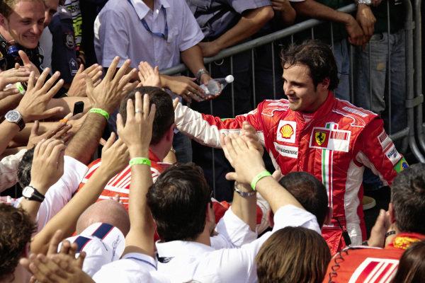 Felipe Massa celebrating with his team in parc fermé.
