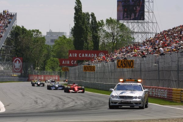 2001 Canadian Grand Prix - RACEMontreal, Canada. 10th June 2001.Michael Schumacher leads behind the safety car.World Copyright - LAT PhotographicRef: 8 9 MB Digital File Only