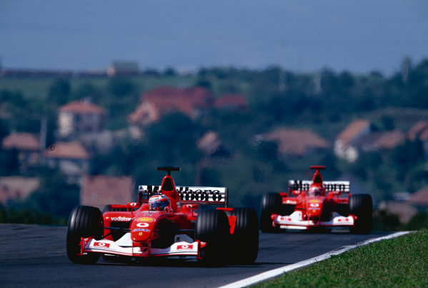 2002 Hungarian Grand Prix.Hungaroring, Budapest, Hungary. 16-18 August 2002.Rubens Barrichello followed by team mate Michael Schumacher (both Ferrari F2002's). They finished in 1st and 2nd positions respectively, to clinch the constructors World Championship. Ref-02 HUN 08.World Copyright - Bellanca/LAT Photographic