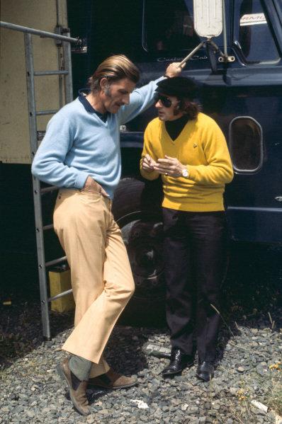 Graham Hill talks to Jackie Stewart.
