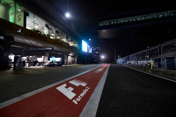 Shanghai International Circuit, Shanghai, China.  Friday 7 April 2017. Lit garages and an empty pit lane as night descends upon the circuit. World Copyright: Steve Etherington/LAT Images ref: Digital Image SNE26695