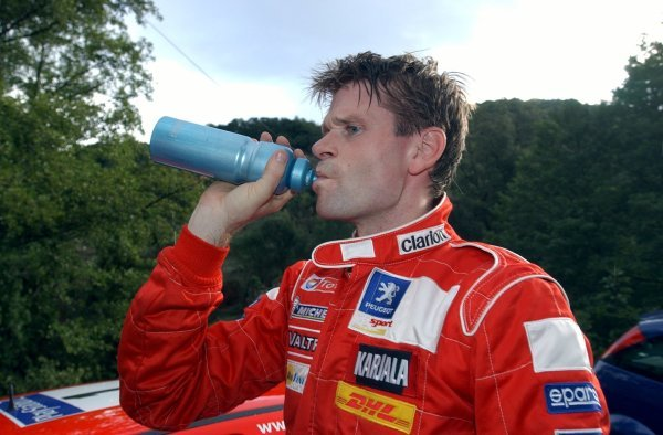 Marcus Gronholm (FIN), Peugeot, takes some refreshment!.World Rally Championship, Rallye de France, Tour de Corse, Corsica, France. Day One, 17 October 2003.DIGITAL IMAGE