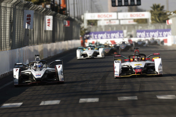 Jose Maria Lopez (ARG), GEOX Dragon Racing, Penske EV-3, battles with Daniel Abt (DEU), Audi Sport ABT Schaeffler, Audi e-tron FE05