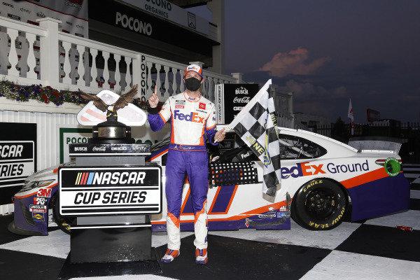 #11: Denny Hamlin, Joe Gibbs Racing, Toyota Camry FedEx Ground celebrates his won