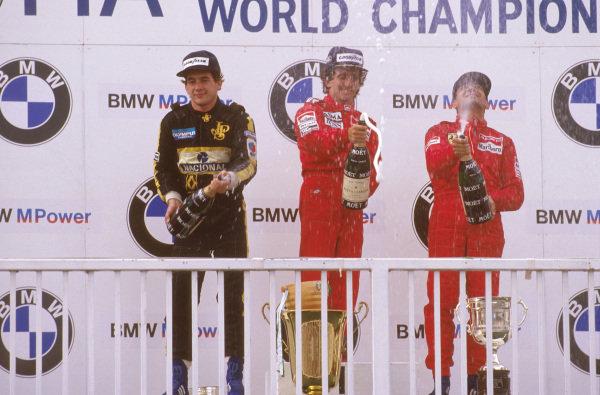 Osterreichring, Zeltweg, Austria.16-18 August 1985.Alain Prost (McLaren TAG Porsche) 1st position, Ayrton Senna (Team Lotus) 2nd position and Michele Alboreto (Ferrari) 3rd position on the podium.Ref-85 AUT 17.World Copyright - LAT Photographic