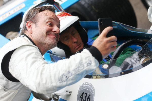 Ruben Barrichello (BRA) and Sir Jackie Stewart asleep