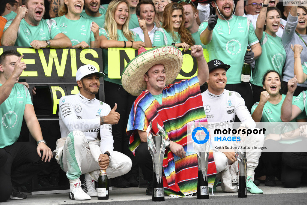 Lewis Hamilton (GBR) Mercedes AMG F1 and Nico Rosberg (GER) Mercedes AMG F1 celebrate with the team at Formula One World Championship, Rd19, Mexican Grand Prix, Race, Circuit Hermanos Rodriguez, Mexico City, Mexico, Sunday 30 October 2016.