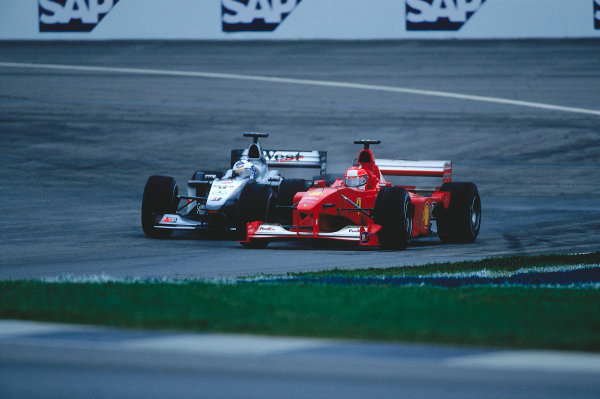 2000 United States Grand Prix.Indianapolis, Indiana, USA. 22-24 September 2000.Michael Schumacher (Ferrari F1-2000) overtakes David Coulthard (McLaren MP4/15 Mercedes) for the lead. They finished in 1st and 5th positions respectively.Ref-2K USA 05.World Copyright - LAT Photographic
