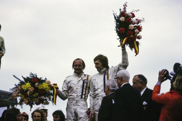 Winners Mike Hailwood and Derek Bell on the podium.