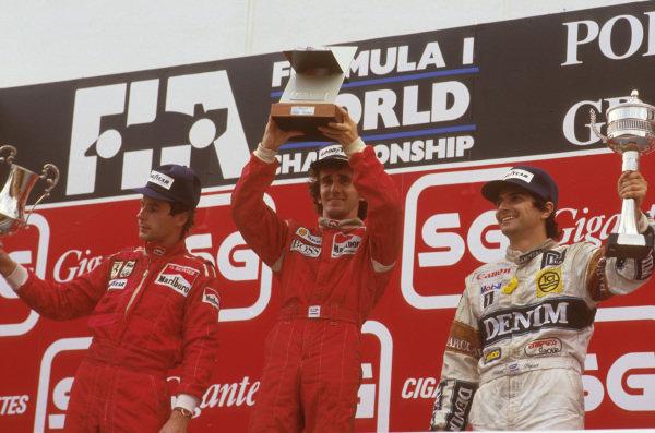 Estoril, Portugal.18-20 September 1987.Alain Prost (McLaren TAG Porsche) 1st position, Gerhard Berger (Ferrari) 2nd position and Nelson Piquet (Williams Honda) 3rd position on the podium.Ref-87 POR 05.World Copyright - LAT Photographic