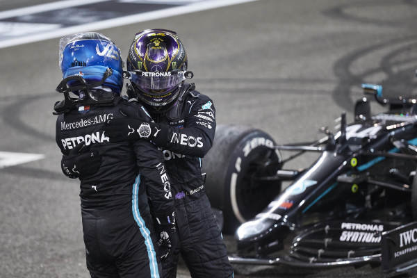 Valtteri Bottas, Mercedes-AMG Petronas F1, 2nd position, and Lewis Hamilton, Mercedes-AMG Petronas F1, 3rd position, congratulate each other on the grid