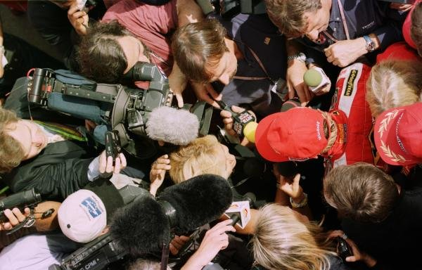 1998 Italian Grand Prix.Monza, Italy.11-13 September 1998.Jacques Villeneuve (Williams-Mecachrome) is mobbed by the press after qualifying second.World Copyright - Steve Etherington/LAT Photographic
