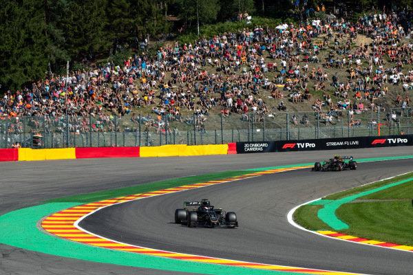 Romain Grosjean, Haas VF-19 leads Kevin Magnussen, Haas VF-19