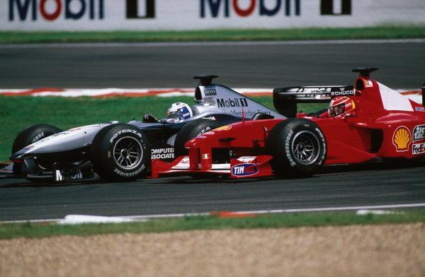 David Coulthard, McLaren MP4-15 Mercedes, battles with Michael Schumacher, Ferrari F1-2000.