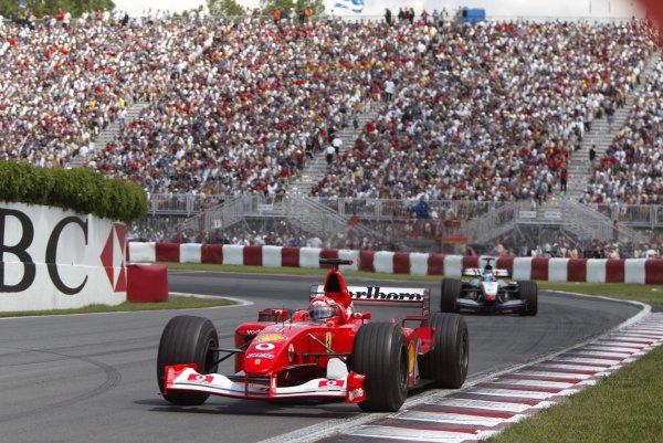 2002 Canadian Grand Prix - Race Montreal, Canada. 9th June 2002 Michael Schumacher (Ferrari F2002) leads Kimi Raikkonen (McLaren MP4/17-Mercedes). World Copyright: Steve Etherington/LAT ref: Digital Image Only