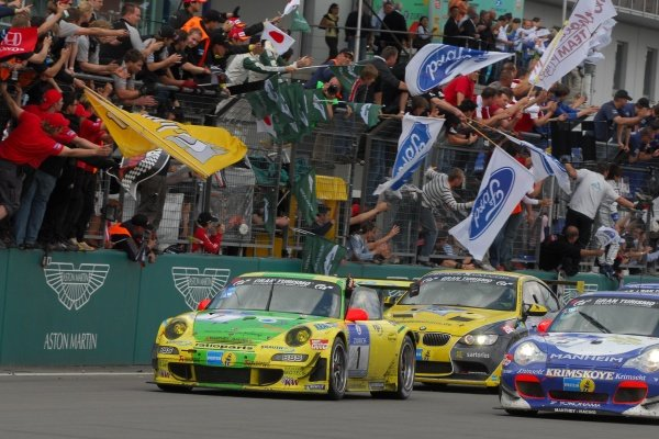 Timo Bernhard (GER) / Marc Lieb (GER) / Romain Dumas (FRA) / Marcel Tiemann (GER) Manthey Racing Porsche 997 GT3-RSR cross the line to win the race.