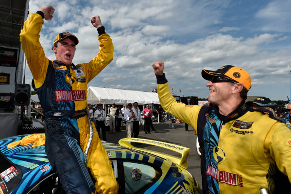 21-22 August 2015, Alton, Virginia USA 13, Porsche, 911, GS, Matt Plumb, Hugh Plumb celebrate the win in victory lane ?2014, Scott R LePage  LAT Photo USA