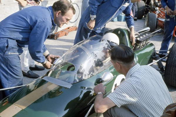 1967 Italian Grand Prix.Monza, Italy. 8-10 September 1967.Jack Brabham (Brabham BT24-Repco) with an experimental all-enclosing windscreen in practice. He finished in 2nd position. Designer Ron Tauranac is in the foreground.World Copyright: LAT PhotographicRef: 35mm transparency 67ITA02