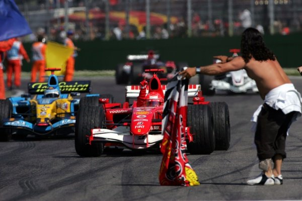Race winner Michael Schumacher (GER) Ferrari 248F1  Formula One World Championship, Rd4, San Marino Grand Prix, Race Day, Imola, Italy, 23 April 2006.  DIGITAL IMAGE BEST IMAGE