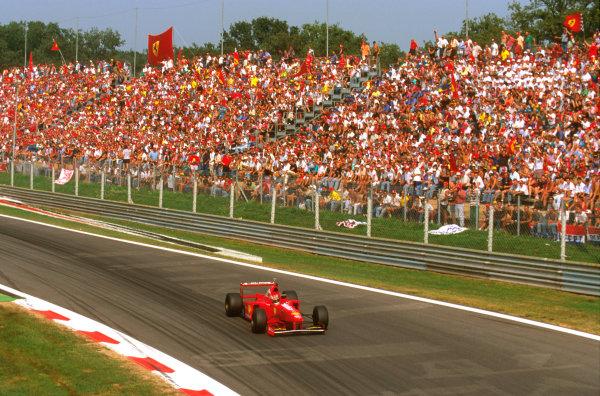 Monza, Italy.5-7 September 1997.Michael Schumacher (Ferrari F310B) 6th position at Parabolica.Ref-97 ITA 06.World Copyright - LAT Photographic
