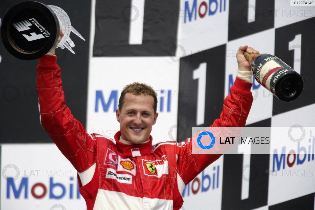 2006 German Grand Prix - Sunday Race Hockenheim, Germany. 27th - 30th July. Michael Schumacher (1st position), Ferrari, celebrates on the podium. World Copyright: Charles Coates/LAT Photographic ref: Digital Image ZK5Y2479