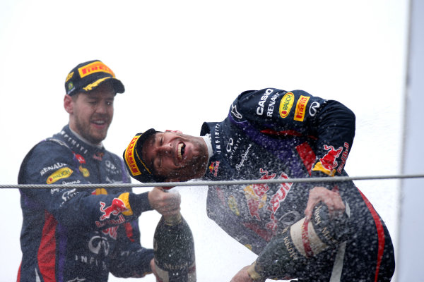 Interlagos, Sao Paulo, Brazil. Sunday 24th November 2013.  Sebastian Vettel, Red Bull Racing, 1st position, sprays team mate Mark Webber, Red Bull Racing, 2nd position, with CHampagne on the podium. World Copyright: Glenn Dunbar/LAT Photographic. ref: Digital Image _89P5996