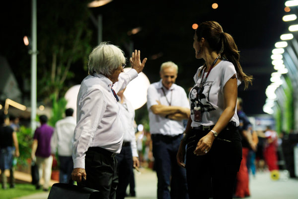 Marina Bay Circuit, Singapore. Saturday 21st September 2013. Bernie Ecclestone in the paddock with his wife. World Copyright: Charles Coates/LAT Photographic. ref: Digital Image _X5J9691