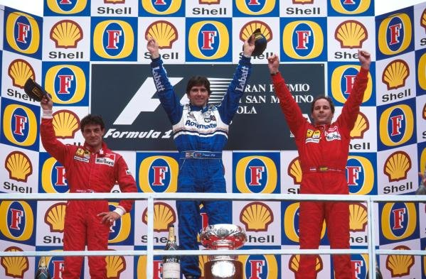 Damon Hill (GBR) Williams(centre) celebrates his win with Ferrari's Jean Alesi (FRA) second (left) and Gerhard Berger (AUT) third.