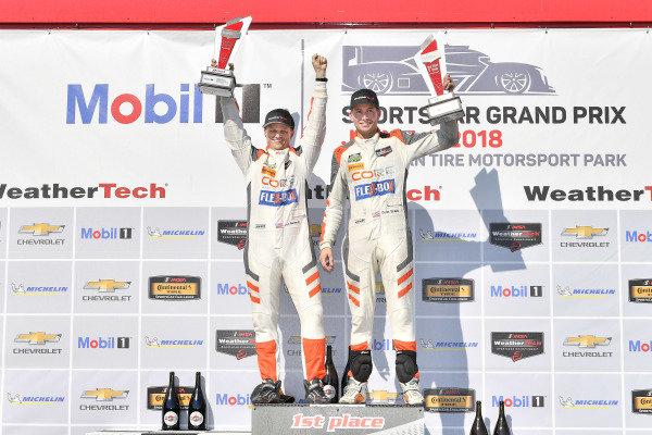 #54 CORE autosport ORECA LMP2, P: Jon Bennett, Colin Braun celebrates the win on the podium