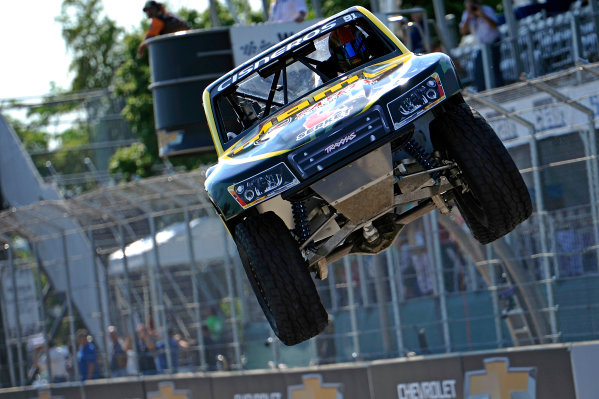 30 May-1 June, 2014, Detroit, Michigan, USA The #91 Truck of Henrique Cisneros gets sideways over a jump and then crashing into a barrier upon landing. ?2014, F. Peirce Williams LAT Photo USA