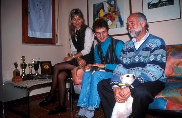 Jarno Trulli (ITA) at home with his mother and father and pet cat and dog.