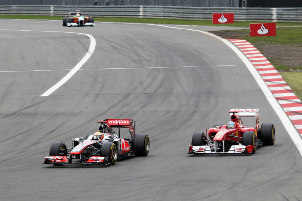 Lewis Hamilton (GBR) McLaren MP4/26 and Fernando Alonso (ESP) Ferrari 150 Italia battle for position.  Formula One World Championship, Rd 10, German Grand Prix, Race, Nurburgring, Germany, Sunday 24 July 2011.  BEST IMAGE