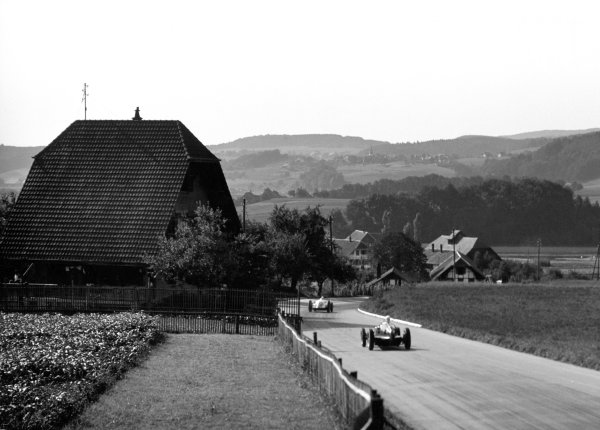 1938 Swiss Grand Prix.  Bern, Switzerland. 21st August 1938.  Jean-Pierre Wimille (Alfa Romeo 312) follows Christian Kautz (Auto Union D) into Eymatt Corner.  Ref: RF38_SWI_27. World Copyright: Robert Fellowes/LAT Photographic