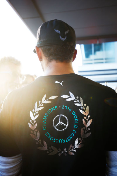 Sochi Autodrom, Sochi, Russia. Sunday 12 October 2014. Lewis Hamilton, Mercedes AMG, 1st Position, with his shirt celebrating the 2014 Constructors title the team secured in Russia. World Copyright: Andy Hone/LAT Photographic. ref: Digital Image _ONY8874